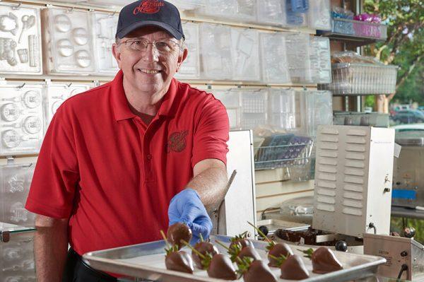 Scott dipping strawberries